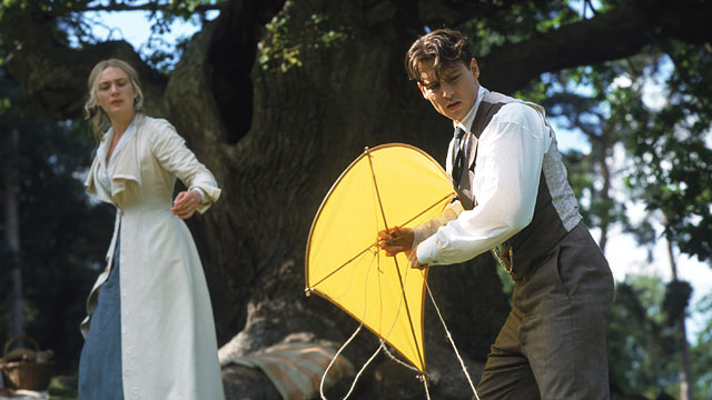 Johnny Depp holds a yellow kite and stands next to Kate Winslet in 'Finding Neverland'