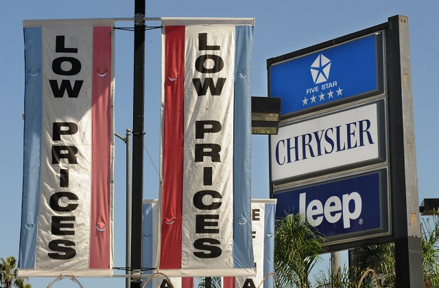 A Chrysler dealer offers low prices at t