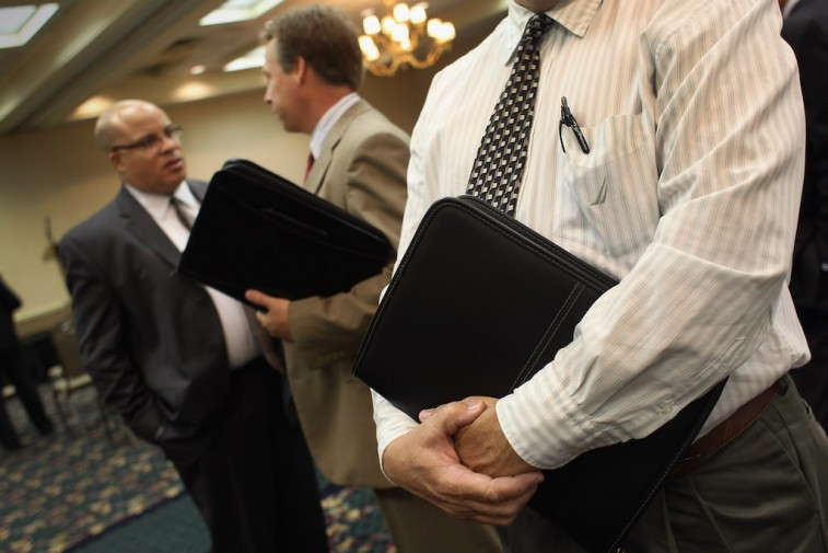 Businessmen talking to each other at a job fair