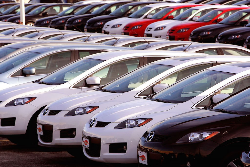Mazda vehicles sit on the lot of a Mazda dealership November 18, 2008 in Countryside, Illinois. In an attempt to raise some desperately needed cash Ford Motor Company reportedly plans to sell 20.4 percent of its 33.4 percent ownership of Mazda. (Photo by Scott Olson/Getty Images)
