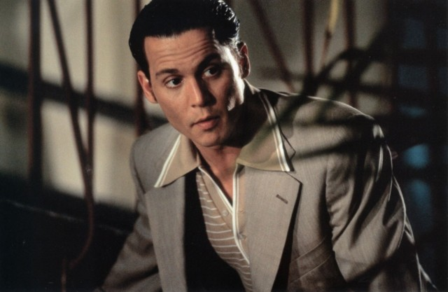 Johnny Depp wears a gray suit and stares to the left in 'Donnie Brasco'.