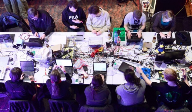 Participants work at their laptops at the annual Chaos Computer Club (CCC) computer hackers' congress, called 29C3, on December 28, 2012 in Hamburg, Germany. The 29th Chaos Communication Congress (29C3) attracts hundreds of participants worldwide annually to engage in workshops and lectures discussing the role of technology in society and its future. (Photo by Patrick Lux/Getty Images)