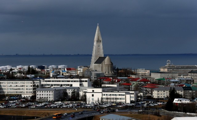 REYKJAVIK, ICELAND - APRIL 07: Buildings surround the Hallgrimskirkja tower in the Icelandic capital on April 7, 2014 in Reykjavik, Iceland. Since the financial meltdown of 2008 which saw the Icelandic economy come close to collapse the island has been slowly recovering and unemployment levels are beginning to return to normal. (Photo by Matt Cardy/Getty Images)