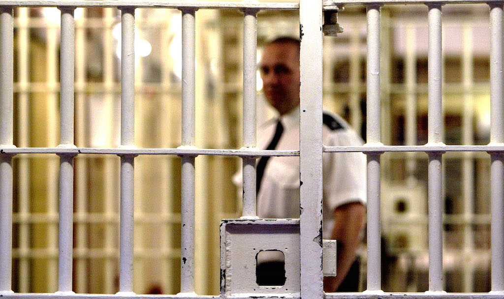 A prison guard stands by in a jail