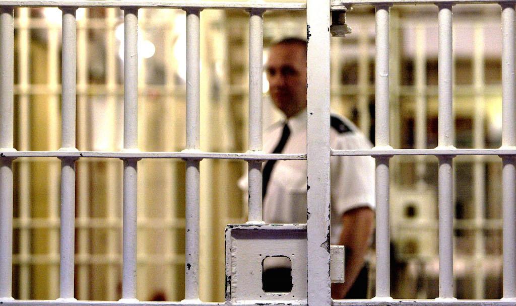 A prison guard inside of a jail