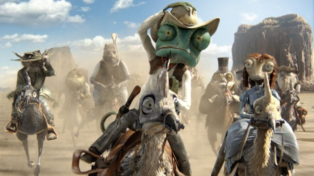 Rango and other characters riding on horses through a desert.