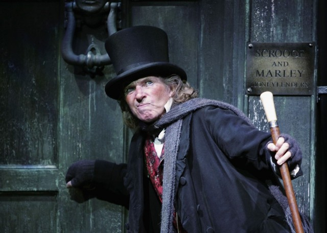 Actor Tommy Steele poses at a photocall to promote his role as Ebenezer Scrooge in the new stage version of 'Scrooge' at the London Palladium on October 27, 2005 in London, England. The limited season will run from October 20 to January 14, 2006. (Photo by MJ Kim/Getty Images)