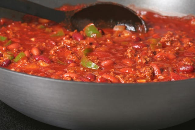 chili in a pan with a serving spoon in it