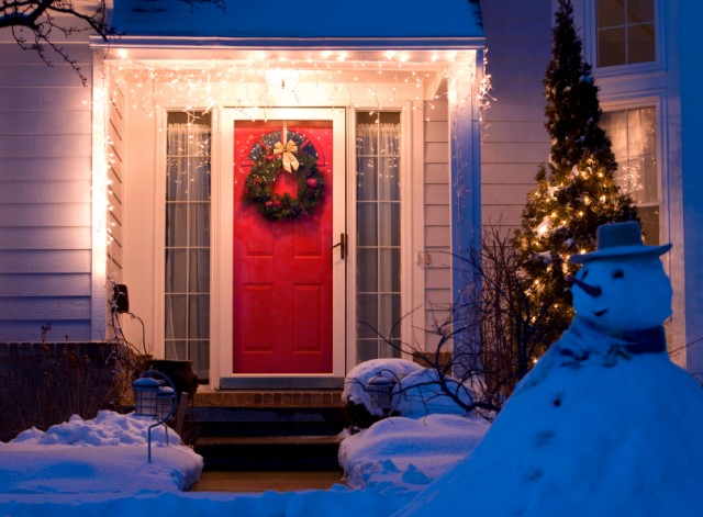 front door of home decorated for the holidays