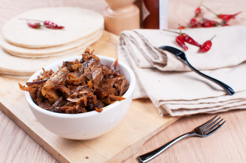 Mexican pulled pork with spices and tortillas