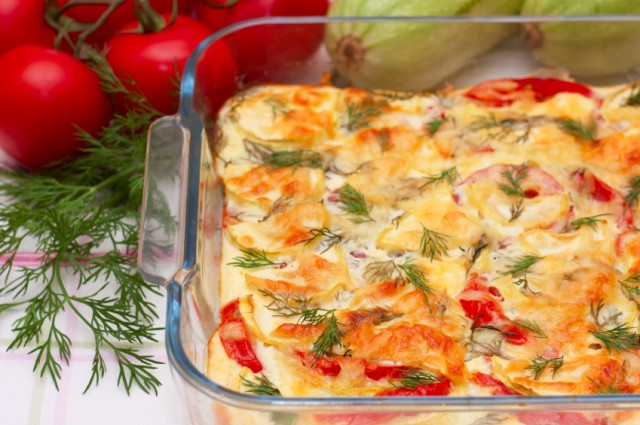 breakfast bake with tomatoes in background
