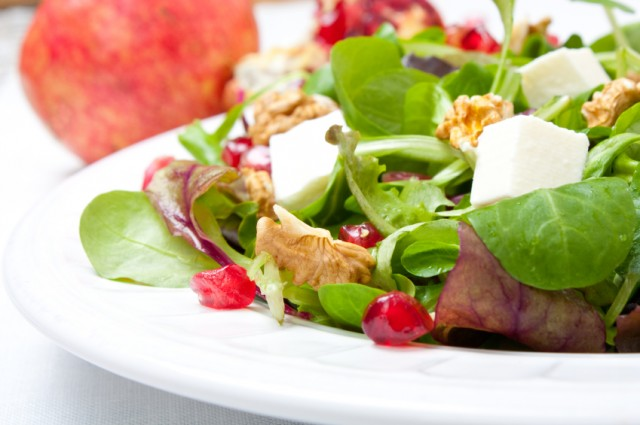 Salad, pomegranate, cheese, nuts
