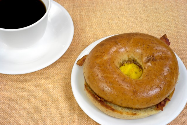 Breakfast bagel sandwich, coffee