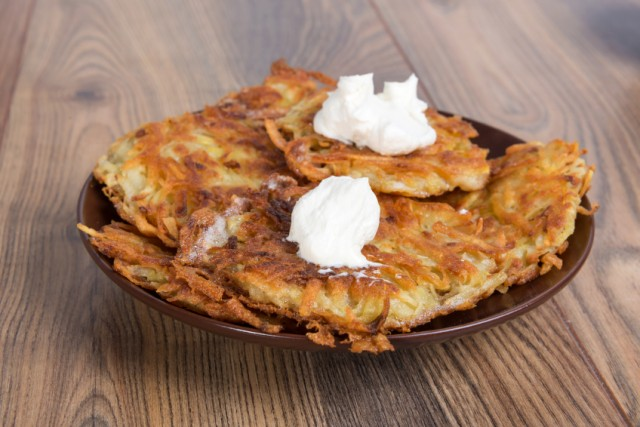 latkes, fritters, potato pancakes with sour cream