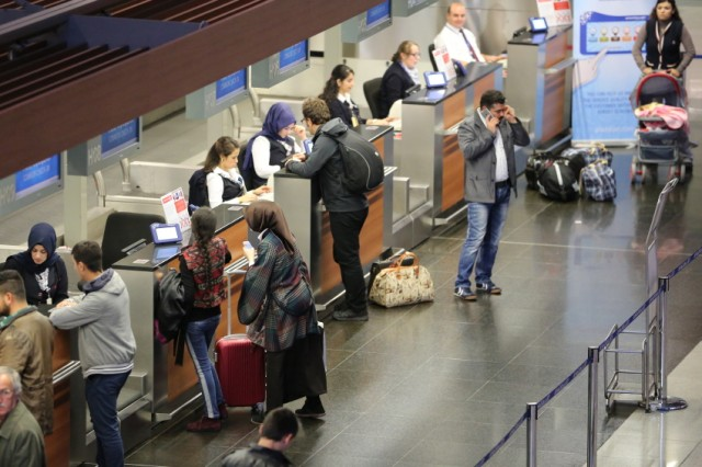 Travelers checking in at the airport