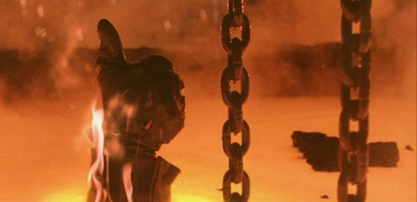 a still of a mans hand giving the thumbs up by chains in Terminator 2: Judgment Day