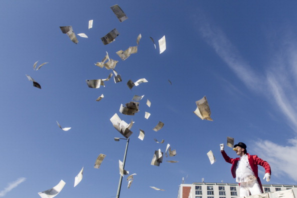 Activist protestors toss money in the air