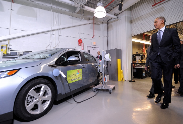 President Barack Obama tours a lab testing electric vehicle infrastructure.