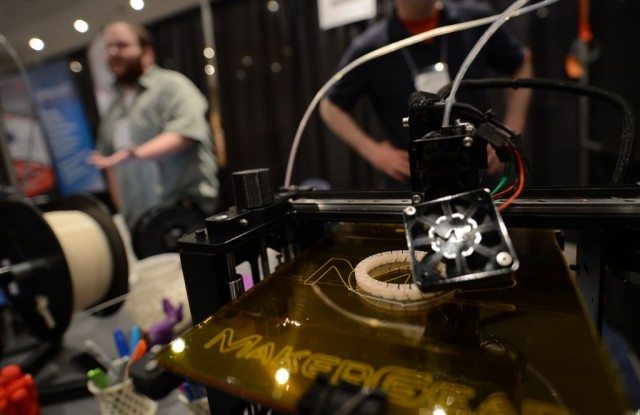 A 3D printer prints an object, during 'Inside 3D Printing' conference and exhibition in New York, April 22, 2013. The exhibition features on April 22-23, 2013, tutorials and seminars offering blueprints on how to invest and utilize 3D printing in coming years, as well as leading manufacturers and developers displaying their latest 3D printers and services. (Photo by Emmanuel Dunand/AFP/Getty Images)