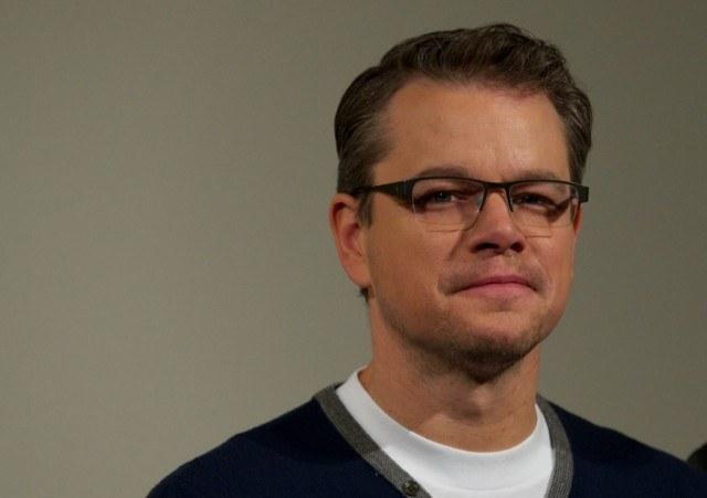 Matt Damon poses for the camera in glasses