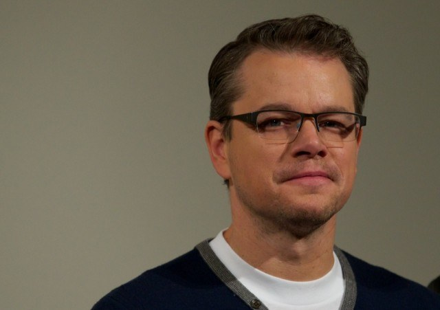 Matt Damon poses for the camera in glasses
