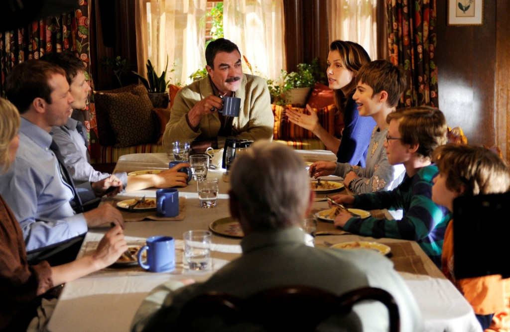 A family sits around a dinner table on Blue Bloods