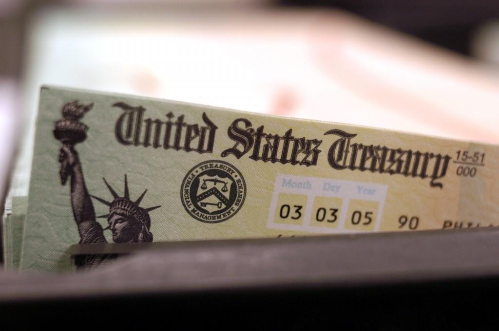 Blank Social Security checks are run through a printer at the U.S. Treasury printing facility