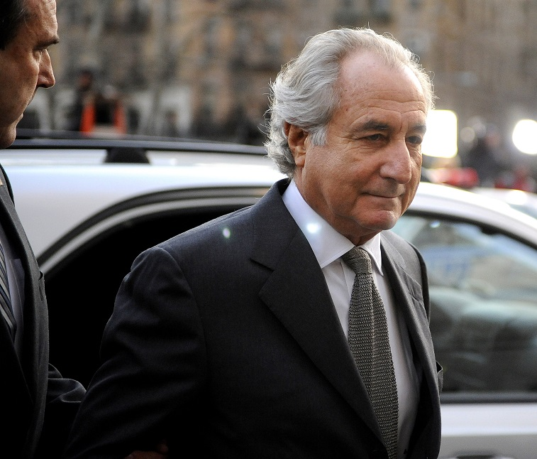 Bernie madoff in a black suit getting out of a car