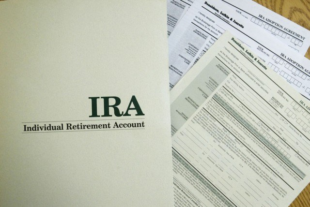An Individual Retirement Account application form from the Enrichment Group is shown July 17, 2002 in Miami, Florida. Many retirement accounts are under pressure as the market goes through its current volatility. (Photo by Joe Raedle/Getty Images)
