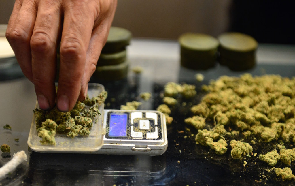 A vendor weighs buds for card-carrying medical marijuana patients attending Los Angeles' first-ever cannabis farmer's market at the West Coast Collective medical marijuana dispensary, on the fourth of July, or Independence Day, in Los Angeles, California on July 4, 2014 where organizer's of the 3-day event plan to showcase high quality cannabis from growers and vendors throughout the state. (Photo by Frederic J. Brown/AFP/Getty Images)