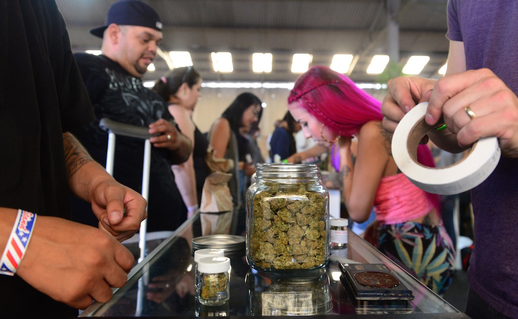 Card-carrying medical marijuana patients attend Los Angeles' first-ever cannabis farmer's market at the West Coast Collective medical marijuana dispensary, on the fourth of July, or Independence Day, in Los Angeles, California on July 4, 2014 where organizer's of the 3-day event plan to showcase high quality cannabis from growers and vendors throughout the state. (Photo by Frederic J. Brown/AFP/Getty Images)