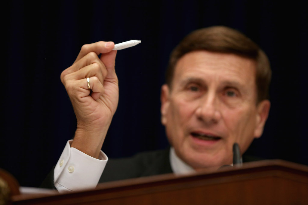 John Mica (R-FL) holds a fake hand-rolled cigarette during a hearing about marijuana laws in 2014