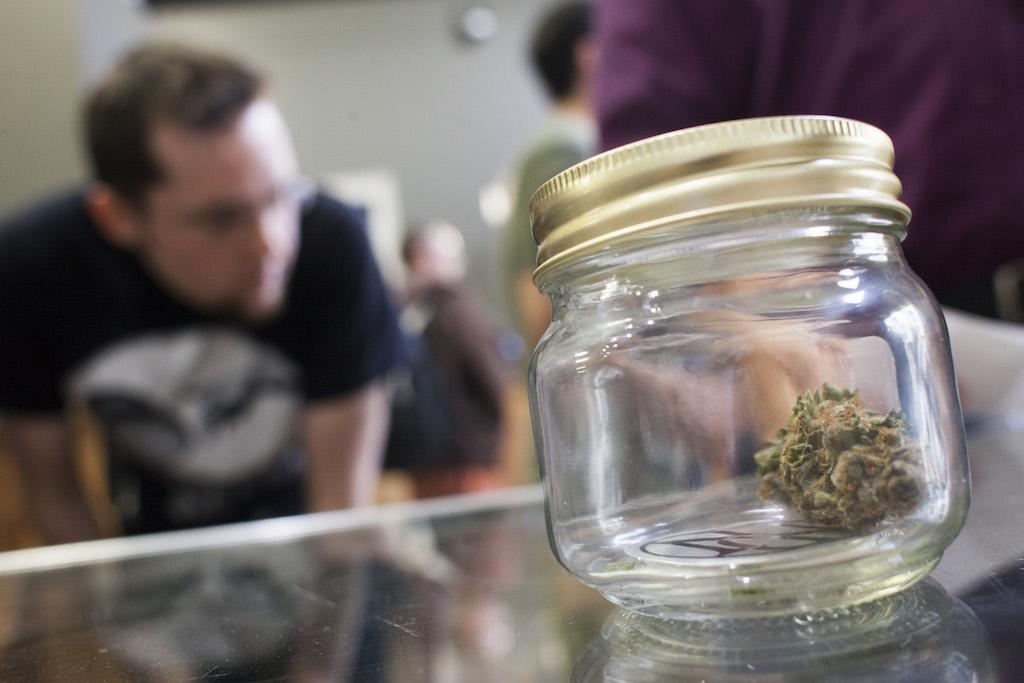 Customers shop for marijuana at Top Shelf Cannabis, a retail marijuana store in Bellingham, Washington