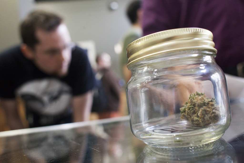 Customers shop for marijuana at Top Shelf Cannabis, a retail marijuana store, on July 8, 2014 in Bellingham, Washington. Top Shelf Cannabis was the first retail marijuana store to open today in Washington state, nearly a year and a half after the state's voters chose to legalize marijuana. (Photo by David Ryder/Getty Images)