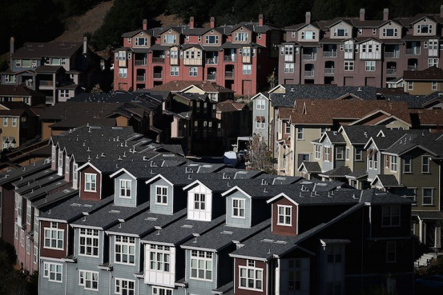 Rows of new homes line a street in a housing development on December 4, 2013 in Oakland, California. (Photo by Justin Sullivan/Getty Images)