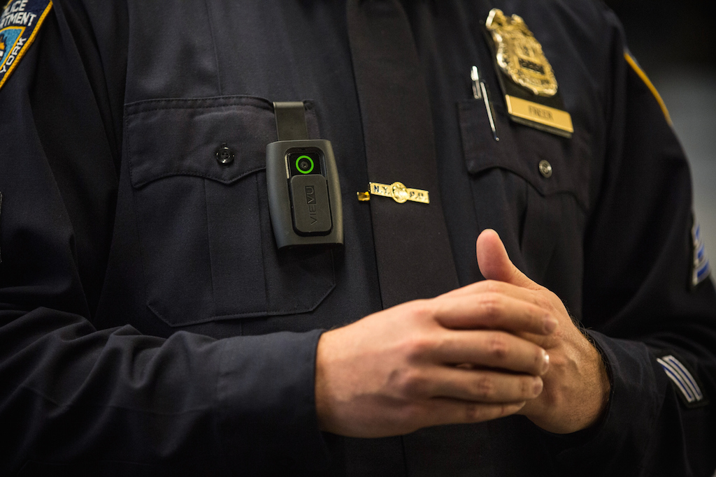 New York Police Department (NYPD) Sergeant Joseph Freer demonstrates how to use and operate a body camera during a media press conference on December 3, 2014 in New York City. The NYPD is beginning a trial exploring the use of body cameras; starting Friday NYPD officers in three different precincts will begin wearing body cameras during their patrols. (Photo by Andrew Burton/Getty Images)
