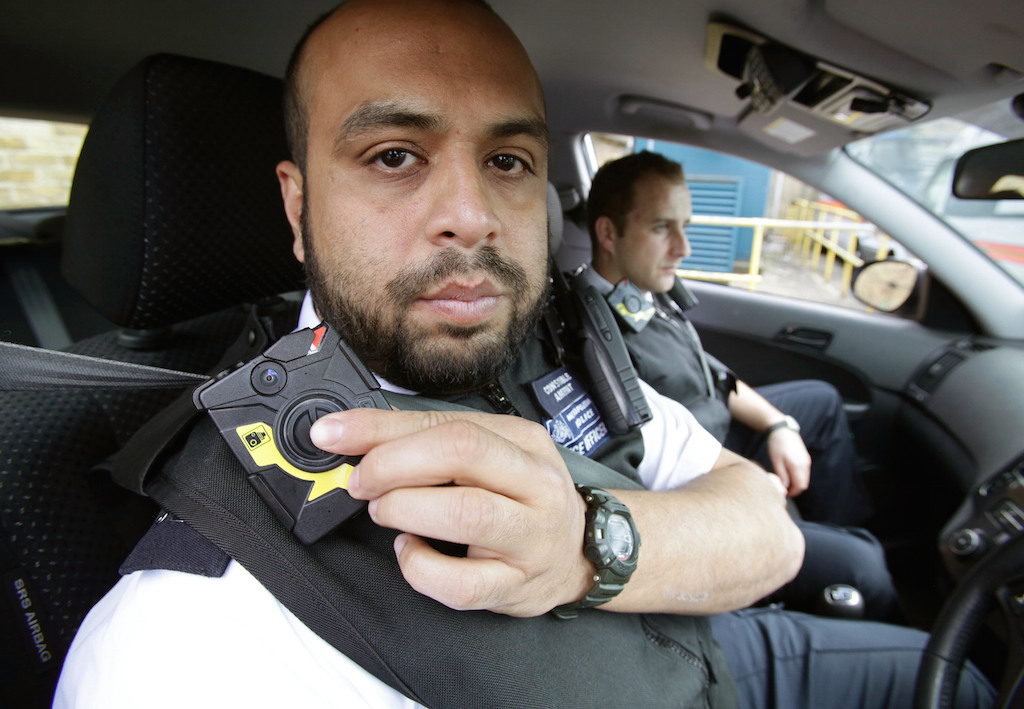 Police wear body cameras.
