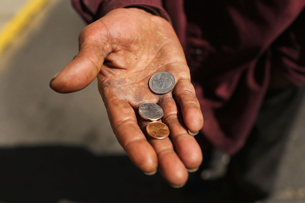 A homeless man panhandles on the street on October 11, 2012 in Camden, New Jersey. (Photo by Spencer Platt/Getty Images)
