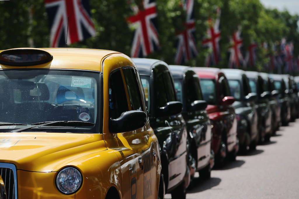 A London taxi's line up on The Mall during a protest against a new smart phone app, 'Uber' on June 11, 2014 in London, England. London's licensed black taxi drivers are campaigning against the introduction of the 'Uber' taxi smartphone app in the United kingdom. Drivers say that there is a lack of regulation behind the new app. (Photo by Dan Kitwood/Getty Images)