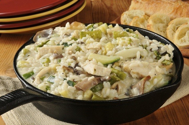 skillet with rice, vegetables and cheese