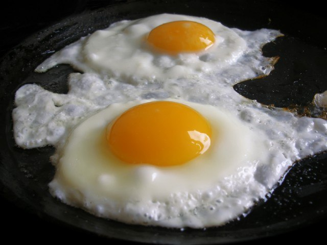 Frying eggs, skillet