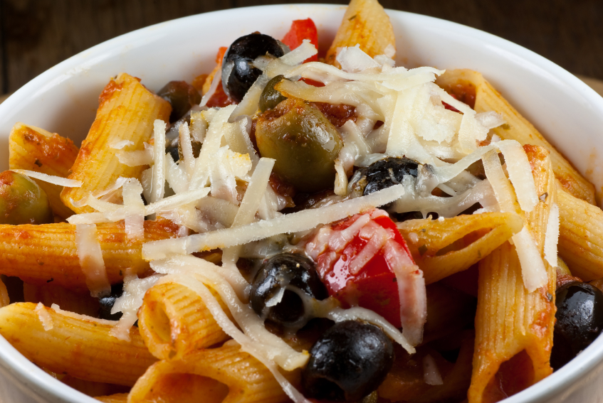 Penne pasta with olives, cheese, tomatoes