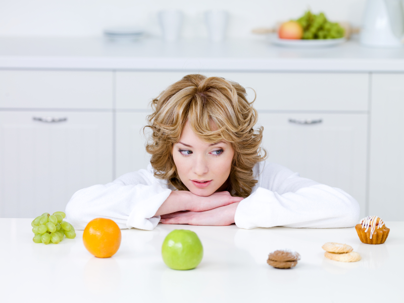 Woman deciding what to eat
