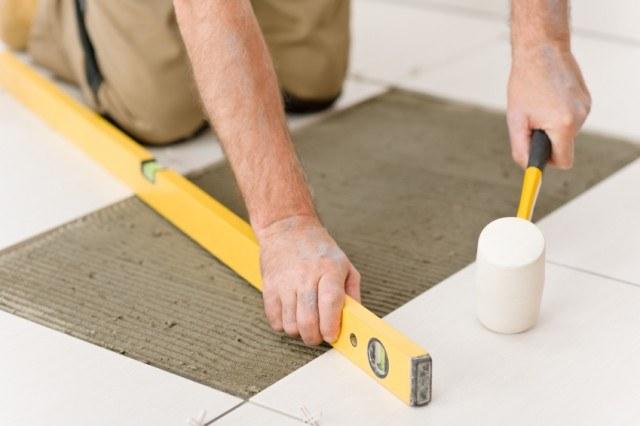 Measuring tile, tiling