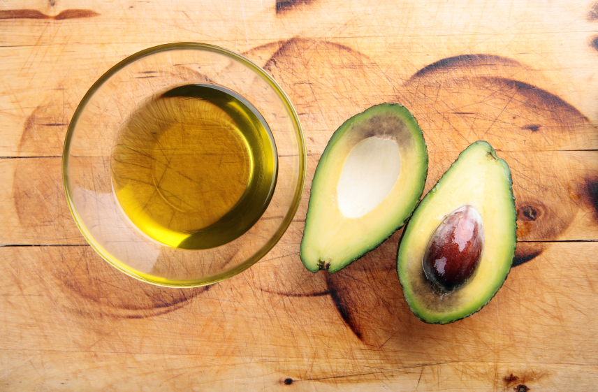 Avocado oil with an avocado cut in half
