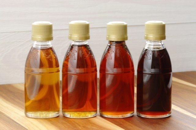 four jars of syrup