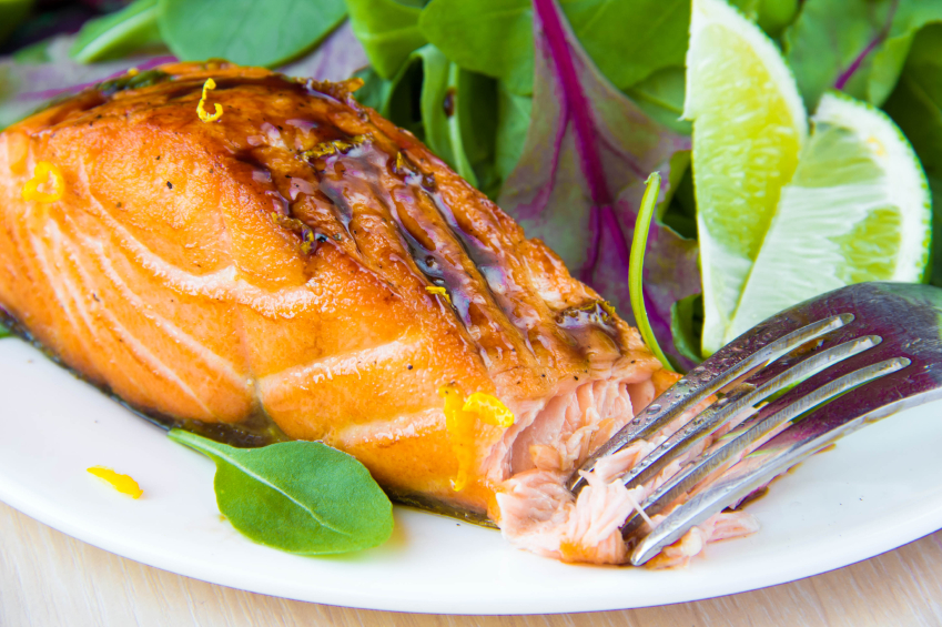 Grilled fillet red salmon, salad with green leaves of lett