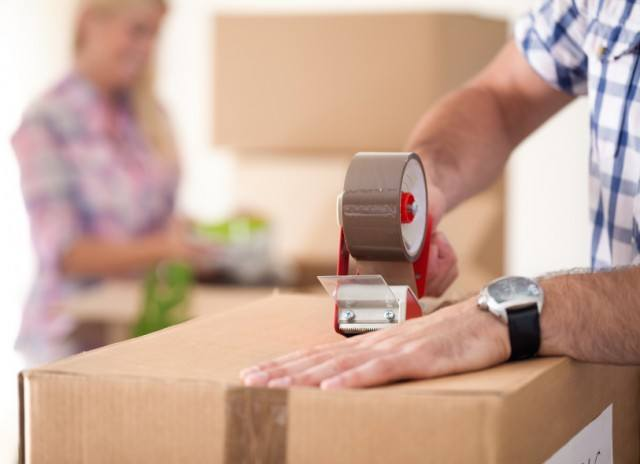 Man packing to move