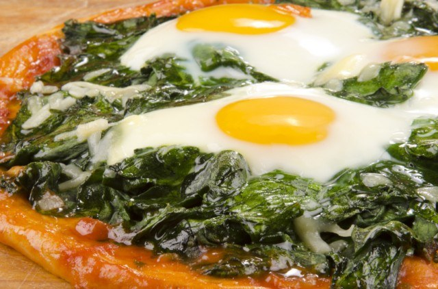 Eggs baked over spinach