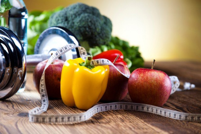 healthy foods and a tape measure